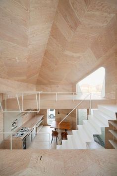 Minimalist Larch-Covered Tsubomi House With 7 Split Levels | DigsDigs