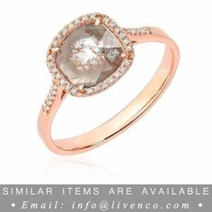 This gorgeous ring features a one of a kind diamond slice surrounded by a halo of hand set white diamonds.