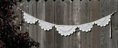 "Lace bunting.  Can you imagine this as a ""trim"" for a burlap covered table at a wedding?  I can!"