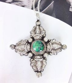 Vintage tribal cross four directions pendant with green turquoise. Symbolic, spiritual, and great bohemian style. A personal favorite from my Etsy shop https://www.etsy.com/listing/471271108/vintage-sterling-silver-and-green