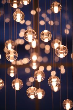 Omer Arbel The 14 is an articulated, seamed cast glass sphere with a frosted cylindrical void that houses either a low voltage (12V, 10Watt halogen/xenon) or proprietary and replaceable LED. Individual pendants are visually quite subtle, but gain tremendous strength when multiplied and clustered in large groups. Light interacts with the bubbles and imperfections of the cast glass to produce a glow reminiscent of small candles floating within spheres of water.