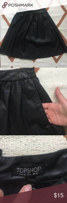 """Topshop Black Skirt Black artificial leather skirt, comes with pockets 🙌🏼, no noticeable wear stains. Zipper detail in the back, great skirt for any occasion! 18"""" Long, 14"""" waist. ❤️ No Trades ❤️ Reasonable offers accepted ❤️ If it doesn't fit, just resell!  ❤️ Enjoy!! Topshop Skirts A-Line or Full"""