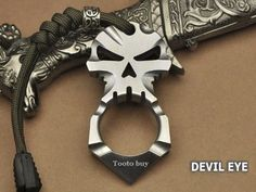 Tooto buy New Design Titanium Ti Ferocious Skull Skeleton Pendant Keychain Self Defense Tool-Devil eye Tooto buy http://www.amazon.com/dp/B00CQWIQ74/ref=cm_sw_r_pi_dp_ZShUub1R0ECRC
