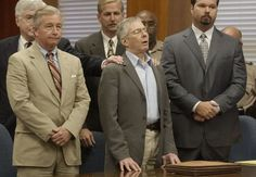 The Jinx Chapter 4 | Surrounded by his attorneys, multi-millionaire murder defendant Robert Durst,center, reacts to a not guilty verdict Tuesday, Nov. 11, 2003, in Galveston, Texas. The cross-dressing son of a New York City real estate tycoon was accused of murder for killing a neighbor at a low-rent Galveston apartment house where they both lived, then dismembering the victim and throwing the body parts into Galveston Bay.