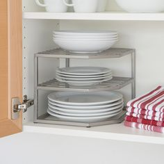 "Seville Classics Corner Kitchen Cabinet Organizer $17.99  Overall: 8.58"" H x 10.23"" W x 10"" D use in inaccessible  back corner of upper cabinets left of sink."