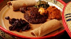 Red split lentils, chicken, diced beetroot and silverbeet served on injera bread at Saba's Ethiopian Restaurant.