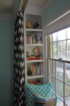 built-in window seat with bookshelves on the inside & curtains on the outside.   ooh, so THAT'S how you can make a window seat nook on a regular window.