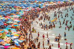 Benidorm, Spain       People sunbathe at Levante Beach on July 22. Spain has set a new record for visitors, with 29.2 million visitors in June, 4.2 percent, more than the same period in 2014.