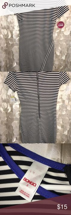 Asymmetrical black & white bodycon dress! This is a perfect dress for a night on the town!! It's asymmetrical and has a blue lined neck line! It's very flattering & fits your body perfectly! BONGO Dresses Midi
