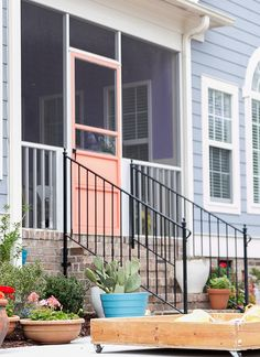 Painted coral door leading to patio adds a lovely punch of color