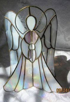 White Iridescent Glass Angel Figurine...I have one of these someone gave me when my Mom died.