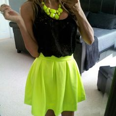 Neon fashion. Lime green skirt with black tank top.