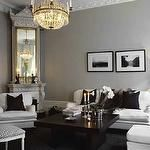 Skonahem - Chic Swedish living room with gray walls paint color, corner fireplace, white ...