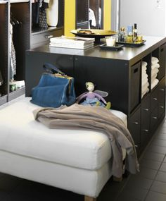 DIY with IKEA: Two EXPEDIT units make a perfect folding station in a laundry room, everyone has a little cubby then for their clean folded clothes, you could even keep the laundry supplies in a square as well.