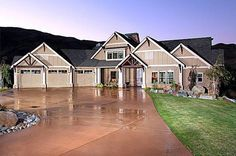 Rear View Splendor - 23286JD | 1st Floor Master Suite, Butler Walk-in Pantry, CAD Available, Craftsman, Drive Under Garage, Luxury, Media-Game-Home Theater, Mountain, Northwest, PDF, Photo Gallery, Premium Collection, Sloping Lot, Vacation | Architectural Designs