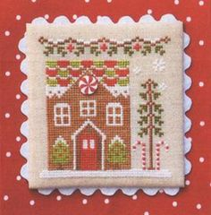 Gingerbread House #1 is the title of this third cross stitch pattern from the Gingerbread Village Series by Country Cottage Needleworks that is stitched with DMC, Classic Colorworks