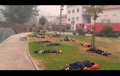 Portuguese firefighters rest after fighting a huge fire for 2 days non-stop