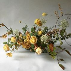 garden inspired floral centerpiece in a golden yellow color palette made of yellow garden roses combined with daucus, chrysanthemum, yellow berries and fall foliage for a fall wedding, fall wedding inspiration, berry centerpiece Ikebana Arrangements, Fall Arrangements, Beautiful Flower Arrangements, Fresh Flowers, Silk Flowers, Beautiful Flowers, Yellow Wedding Flowers, Floral Wedding, Fall Wedding