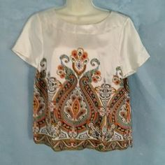 I just discovered this while shopping on Poshmark: TALBOTS  100% SILK SHORT SLEEVE TOP NEW WITH  TAG. Check it out! Price: $15 Size: 16P