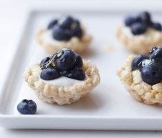mini cereal bowl canape filled with organic Greek yogurt, topped with fresh whole blueberries (from Maine, when in season) and drizzled with local honey.    It's fantastic as a breakfast hors d'oeuvre for weekend brunches, but the sweetness of the cereal bowl (made with marshmallows) makes for an unexpected dessert for fancy schmancy parties anytime.    {Photo: Con Poulos}