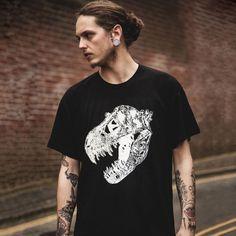 alternative male model with tattoos wearing a black t-rex skull t-shirt