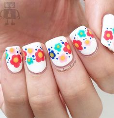 What is girly without flowers? In this preppy nail art design, it's all about bouquets of flowers in different colors.