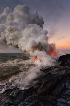 Lava tube directly into the ocean.  Waves crashing up against the lava causing explosions