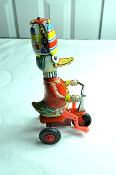 Vintage Windup Toy Tin Duck on Bike, West Germany.