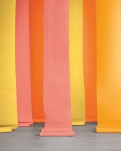 this vibrant display cost less than $10.  It's made from unfurled rolls of Paper Mart crepe paper, which is insanely affordable and light enough to hang from the ceiling with painters' tape. It also comes in 34 hues. Enlist it to create a ceremony marker or dress up a bare wall.  Papermart.com