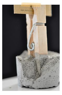 Perfect setup to display pieces of art - cement or plaster of paris + gravel in a paper dixie cup and a clothes pin!