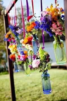 Spring party decor with beautiful hanging flower vases