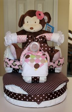 diy diaper tricycle | Pink and brown monkey tricycle of diapers with 100 pampers diapers ...
