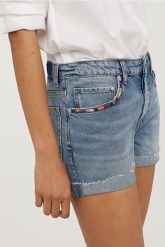 shorts in washed denim with heavily distressed details. Loose fit, regular waist, and button fly. Sewn cuffs at hems. Embroidery On Clothes, Embroidered Clothes, Diy Embroidery, Embroidery On Denim, Diy Embroidered Jeans, Diy Shorts, Diy Jeans, Denim And Lace, Blue Denim