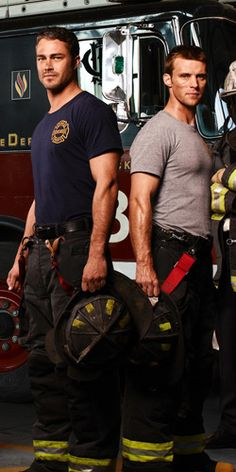 "Taylor Kinney and Jesse Spencer as Chicago firefighters in ""Chicago Fire."" 