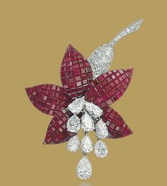 A MYSTERY-SET RUBY AND DIAMOND FUCHSIA BROOCH, BY VAN CLEEF & ARPELS   The flower composed of mystery-set ruby petals, pavé-set diamond calyx and baguette-cut diamond stem, suspending three articulated pear-shaped diamond line stamen, mounted in platinum and gold, 1972, 7.0 cm  Signed Van Cleef & Arpels, no. 23129