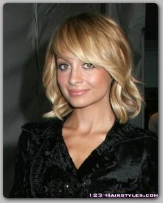 Wavy bob with side swept bangs, same person as the other pin, but with wavy hair like mine, I think I might do this!