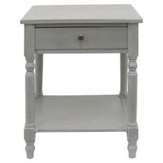 "Wood end table in gray with turned legs and a lower shelf.  Product: End tableConstruction Material: WoodColor: Light grey Features: One drawer Dimensions: 30"" H x 18"" W x 15"" D"