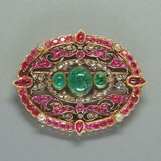 A late 19th century ruby, emerald and diamond brooch,
