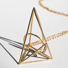 This triangular golden ratio pendent presents the math within nature, beauty within life. The necklace comes with a matching chain. Dimensions: 26x24x41 mm The item is MADE TO ORDER, and it will take