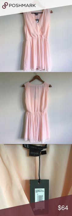 •NWT• Armani Exchange Blush Pink Front Wrap Dress• Beautiful Light Pink Dress. Purchased for a wedding, but never worn. There's one minor spot on the dress. It's located on the right front chest where it wraps. Extremely hard to notice, but I presented a photo of the spot. This dress screams feminine! I love everything about this dress :)   →Color: Blush Pink/Light Pink  →Size: 4 →The front wraps.  →No trades(comments will politely be ignored). →15% off 2+ items  Armani Exchange Dresses