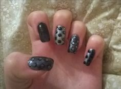 black and silver dots