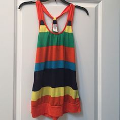 Banded bottom multicolor tank top Super cute multicolored banded bottom tank top. Body Central Tops Tank Tops