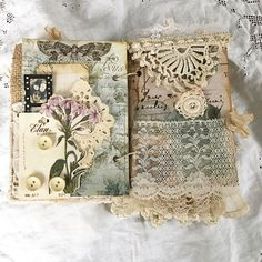 Fabric book journal page layout idea scraps embroidered lace ribbon flower buttons doily layered
