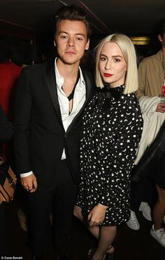 Happy families: Harry posed with glamorous sister Gemma inside the party...