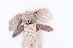Bobbi a handmade knitted bunny rabbit. This soft toy is a great baby gift. Made from a soft cotton yarn and wearing crochet cotton overalls. A baby gift for a newborn or a children's gift for a birthday. This would also make a great Easter bunny!