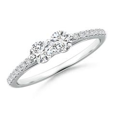 2 Stone Diamond Ring with Diamond Accents. Prong set in 14k gold, this two stone diamond ring with side accents exudes sophisticated charm.