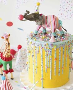 Broad Party Crafts Dollar Stores How To Throw a Fantastic Circus Animal Parade Party. Recreate these adorable circus party ideas to celebrate your little one's next birthday! Elephant Cake Toppers, Elephant Cakes, Elephant Party, Elephant Birthday, Party Animals, Party Animal Theme, Animal Party Food, Animal Themed Birthday Party, Carnival Birthday Parties