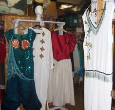 The lovely flapper dress in the foreground is a premium item at The Costume Shop.