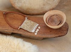 Textile and leather necklace: central square in old linen    http://www.amalthee-creations.com/jewells-55