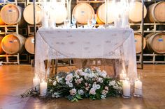 Beautiful Bride + Groom sweetheart table detailed with lace, blush and candles are all things romantic and is the center of attention.